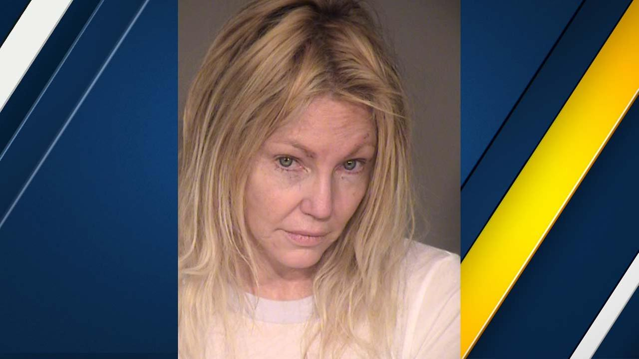 Police search Heather Locklear's home for firearm