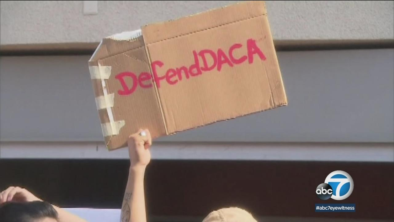 Someone holds up a Defend DACA sign in this undated photo.