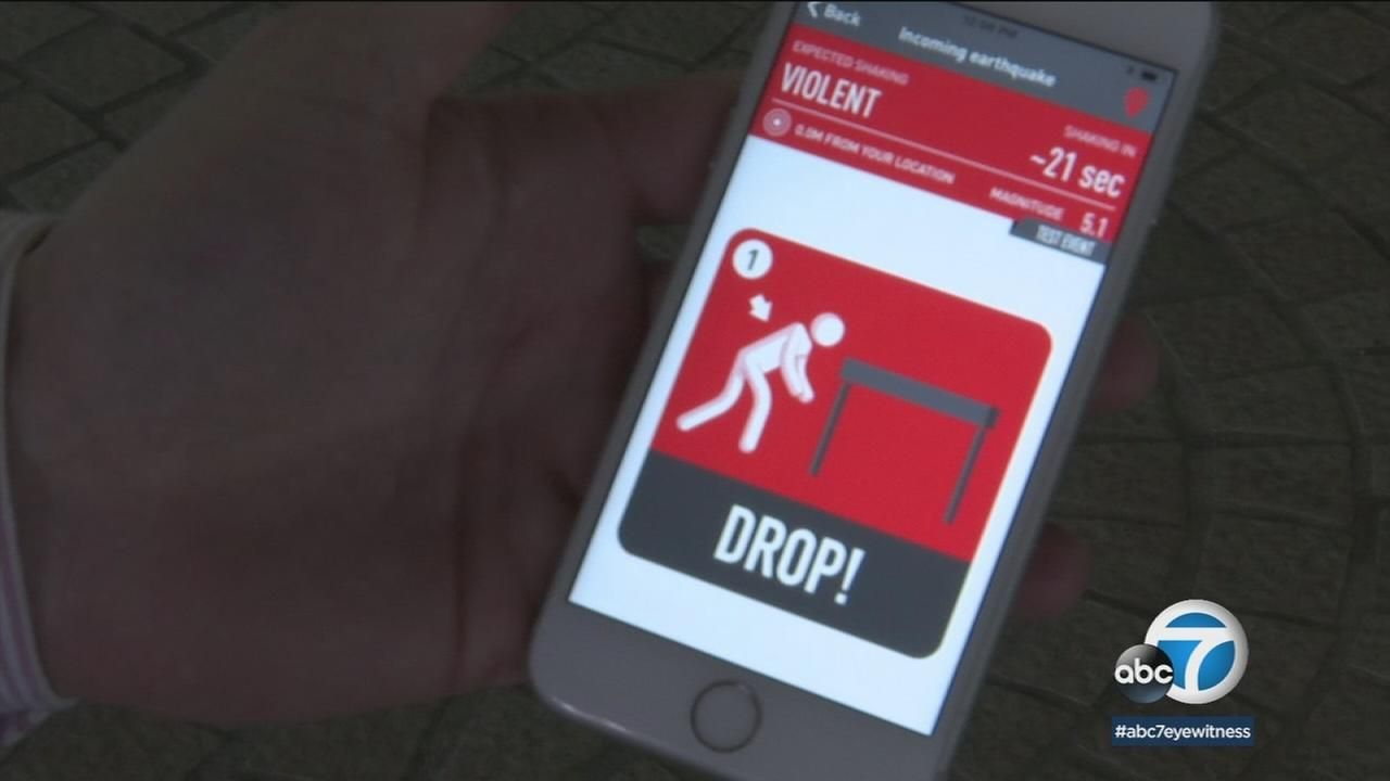 An earthquake early warning app for mobile devices is shown in a photo.