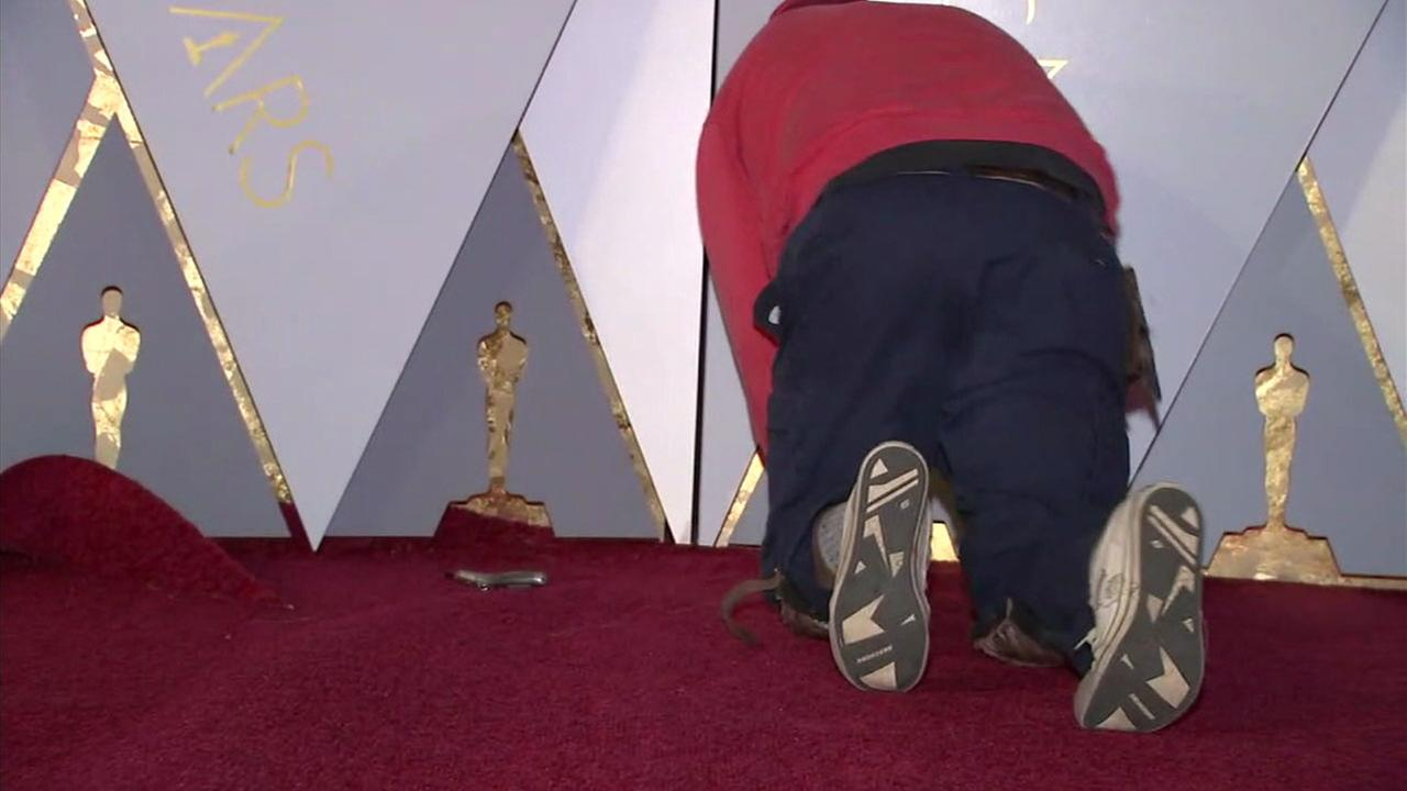 A worker puts together the Oscars red carpet along Hollywood Boulevard.