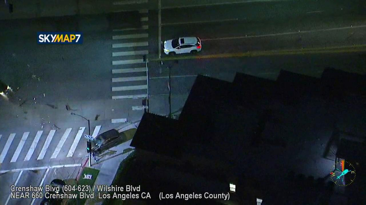 A wild high-speed chase ended in a violent crash on a Mid-City street - and nearly took out a freelance cameraman who was just a little too close recording the action.