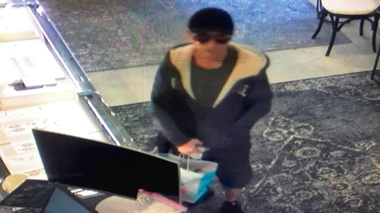 A man who threatened to detonate an explosive device during an attempted robbery of a jewelry store in Santa Monica is seen in a surveillance image, Feb. 28, 2018