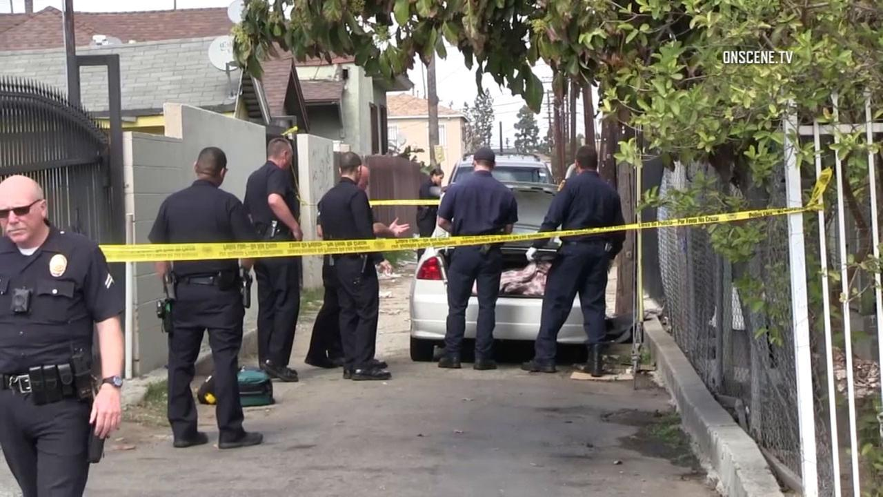 Authorities at the scene where a body was found in a trunk of a car in Vermont Knolls on Thursday, March 1, 2018.