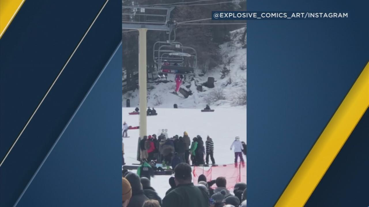 A little girl dangles from a ski lift at Bear Mountain Ski Resort after she slipped from the seat on Saturday, March 3, 2018.