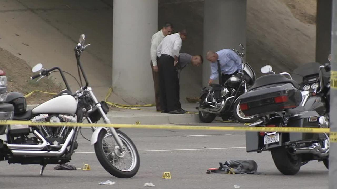 Authorities investigate the scene of a shooting between rival motorcycle gangs on Sunday, Sept. 21, 2014.