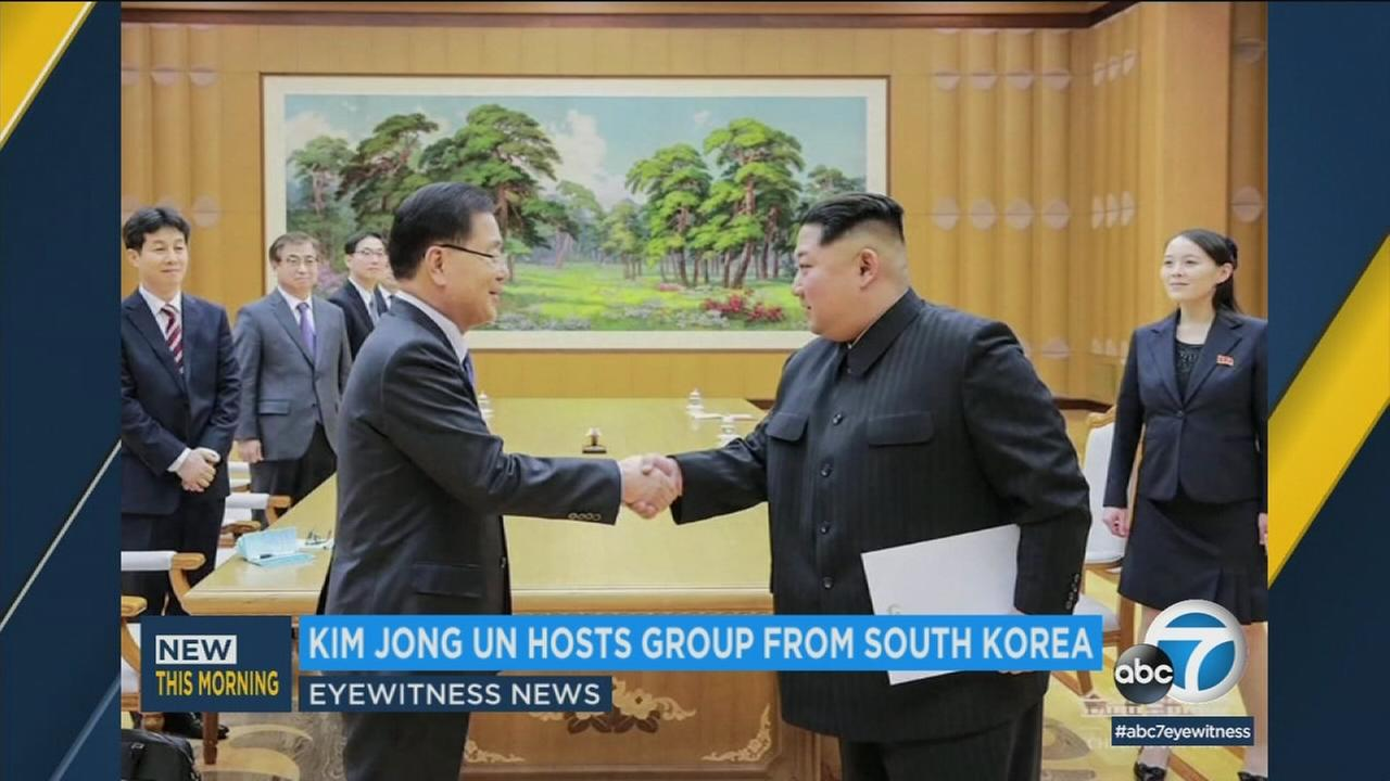A photo of the North and South Korean leaders meeting on Tuesday, March 6, 2018.