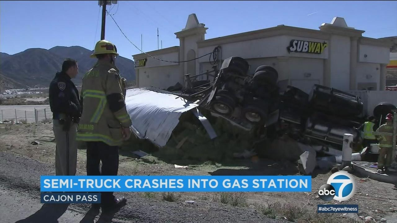 A semi-truck that was traveling eastbound on the 138 Freeway in the Cajon Pass hurtled into a gas station after rolling over multiple times, according to officials.