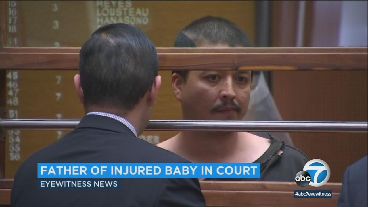 Days after an unresponsive baby was revived by Los Angeles police officers in Westlake, the childs father appeared in court in connection with a related domestic dispute.