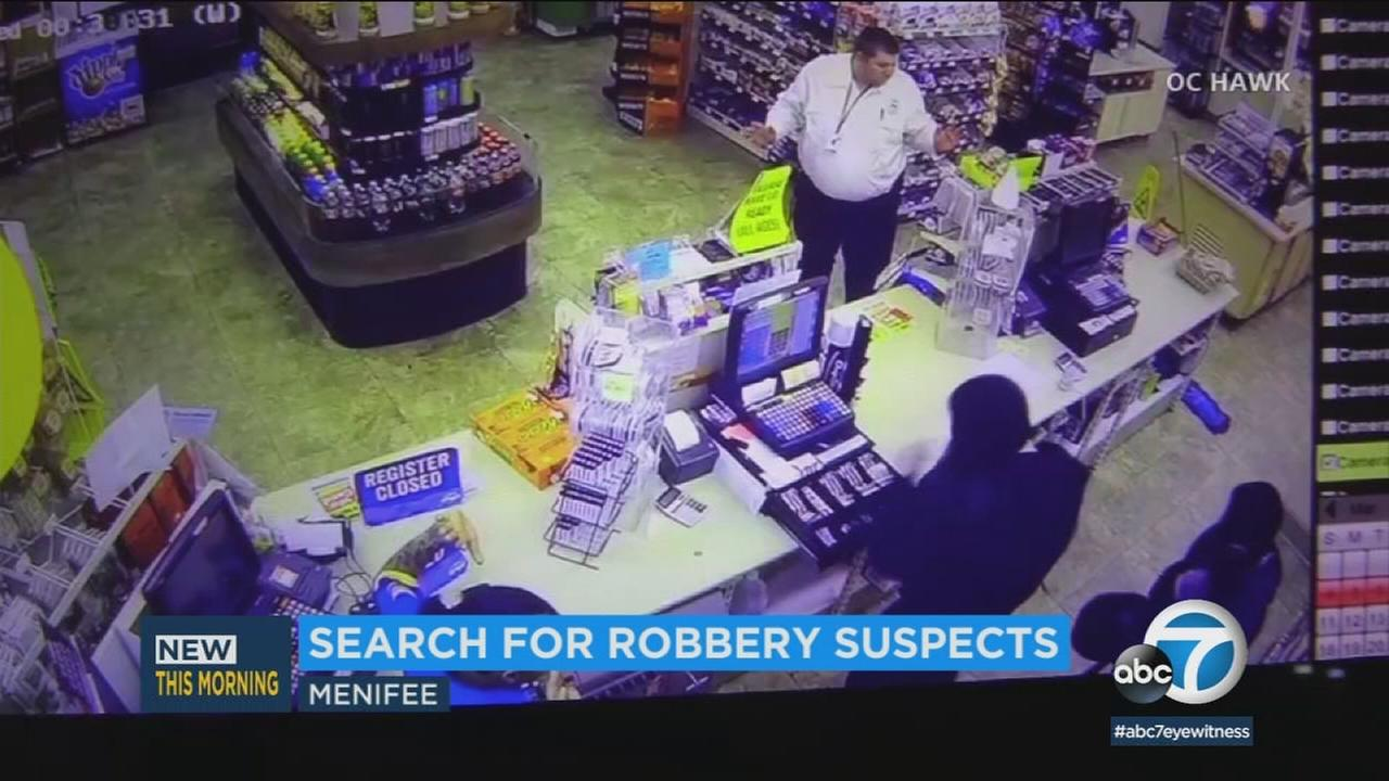A dramatic robbery at a Riverside County gas station was captured on surveillance video and has prompted a search for two suspects.