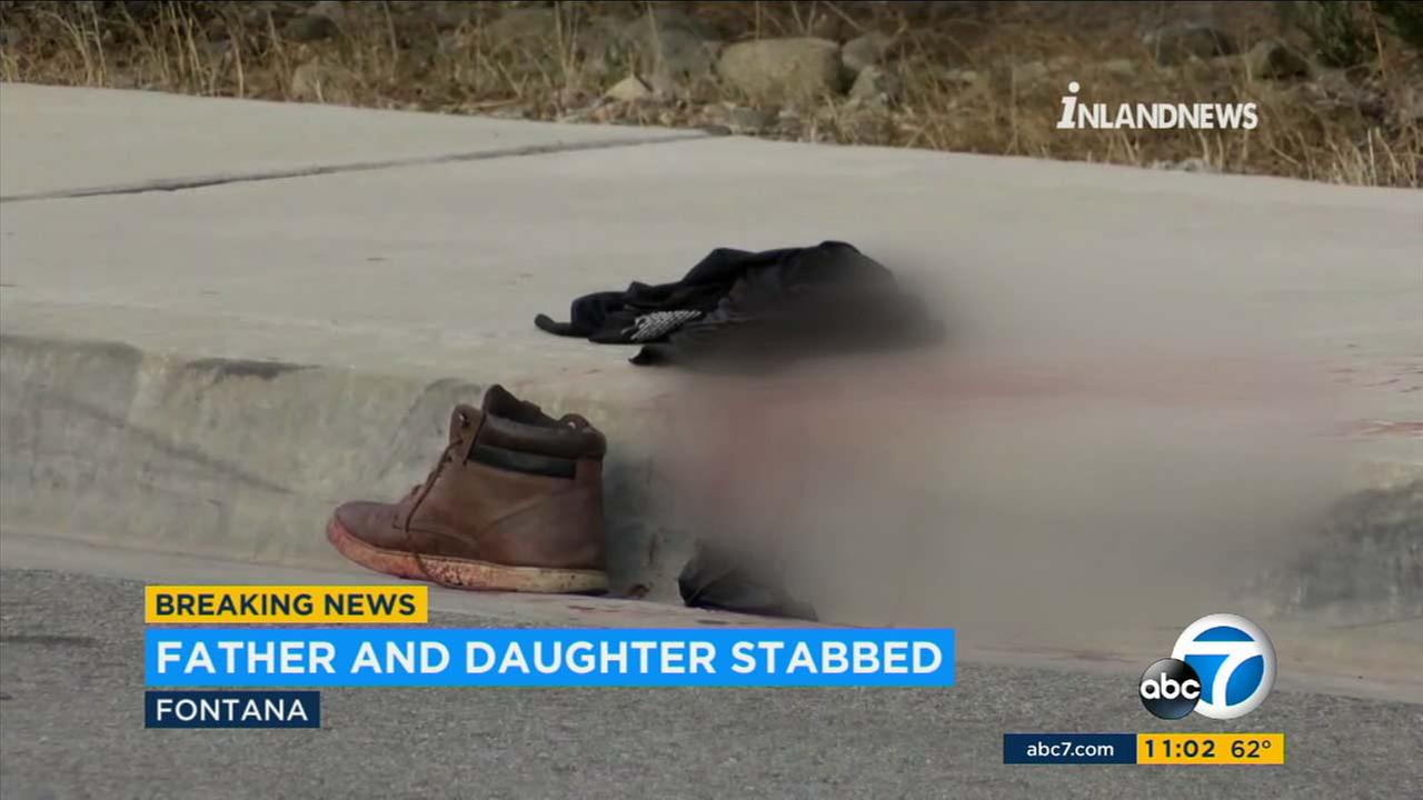 Blood and clothes are seen in a Fontana neighborhood, where a man and his daughter were stabbed on Wednesday, March 7, 2018.