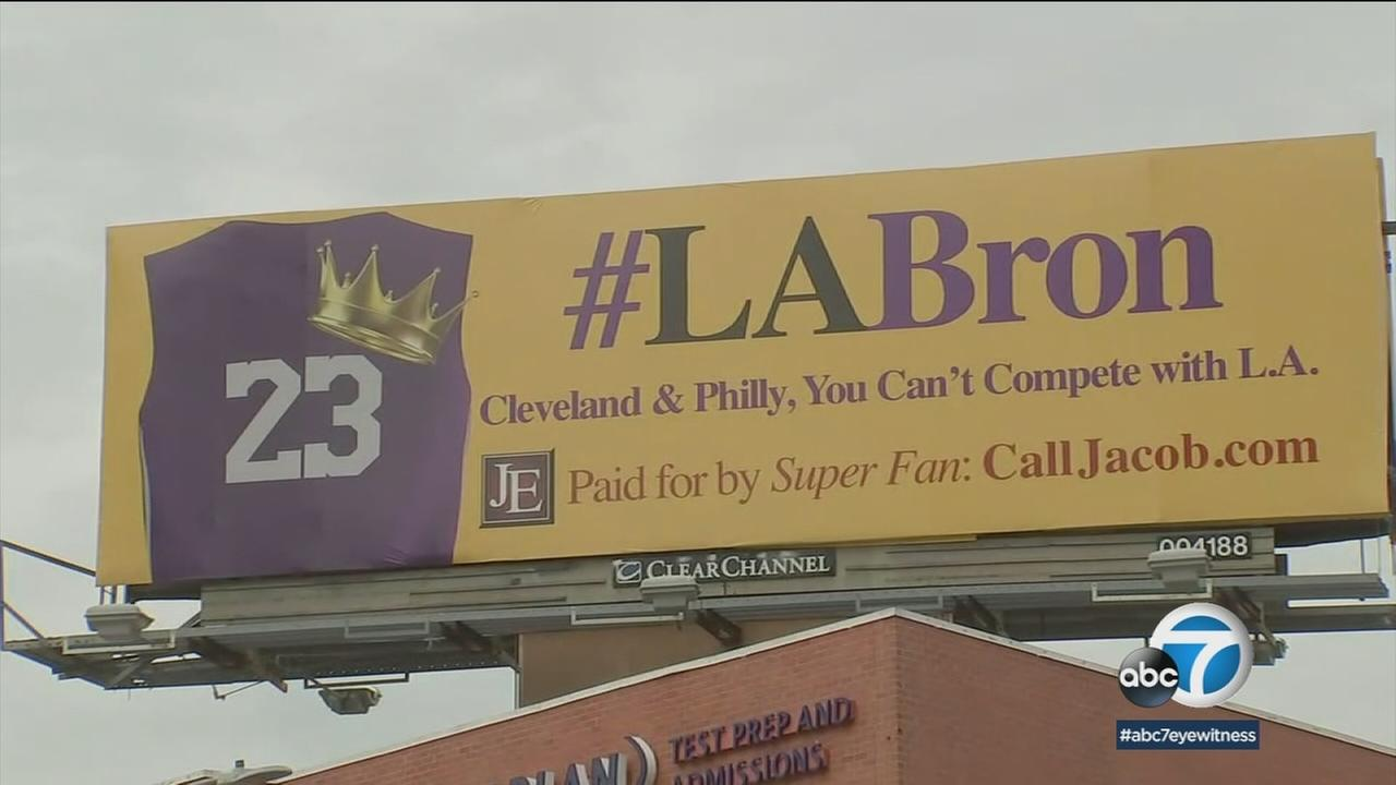 A Lakers superfan has put up billboards across Los Angeles to court LeBron James as the Cavaliers visit town.