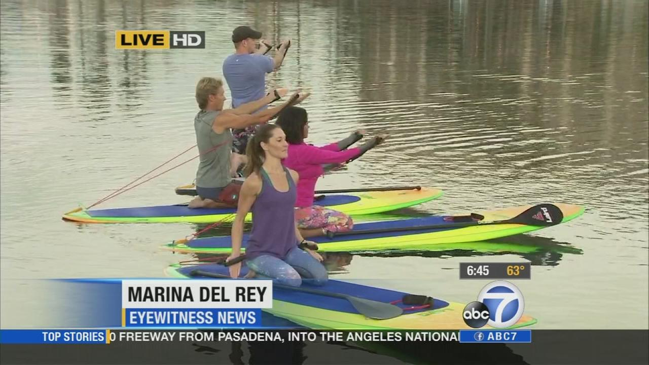 One of the hot new workouts combines stand-up paddleboarding with a workout that has been a favorite for years: pilates.