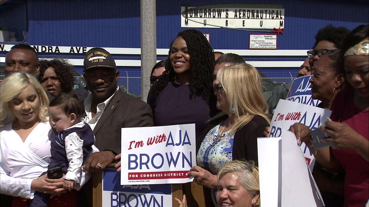 Compton Mayor Aja Brown poses with supporters after announcing Thursday, March 8, 2018, that shes running for congress.