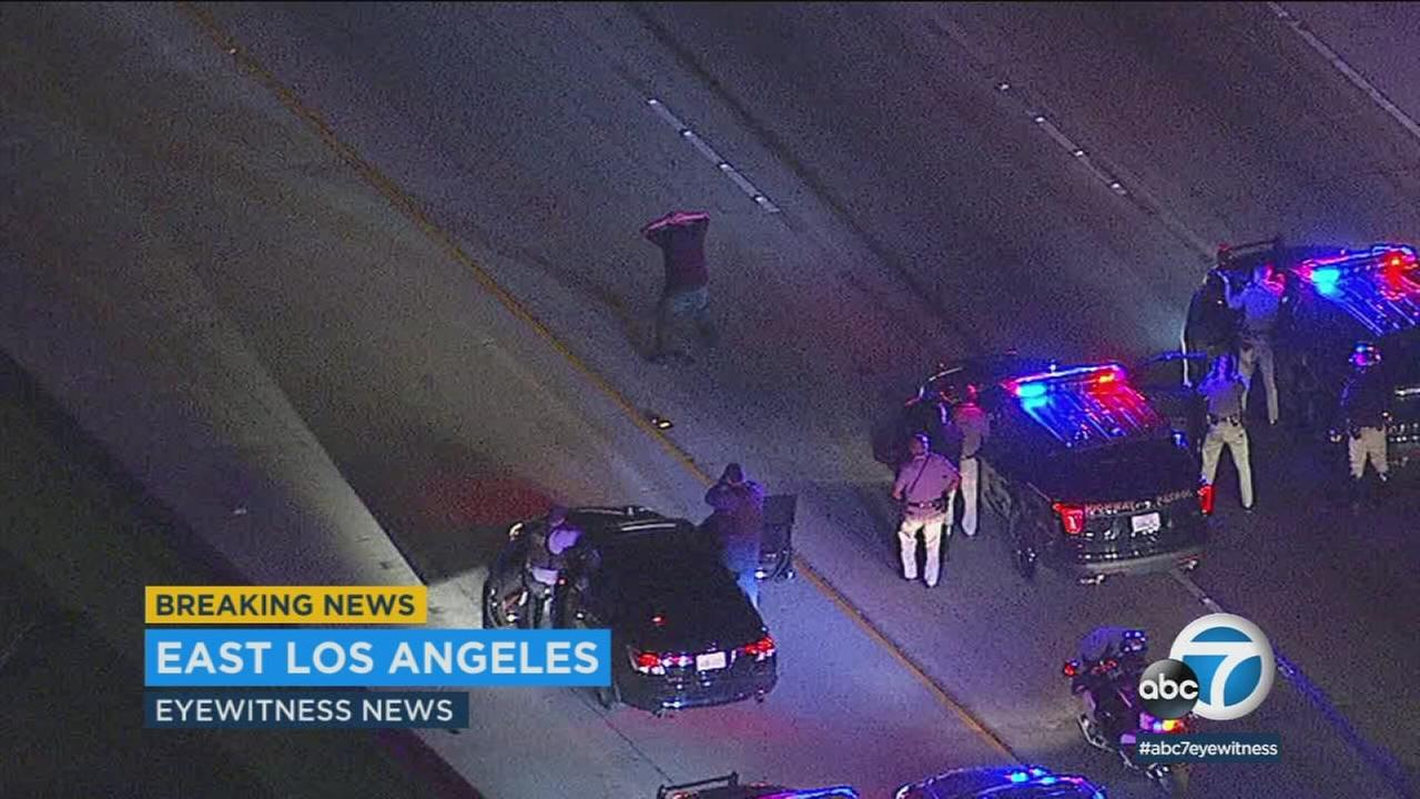 CHP officers chased a suspect from San Bernardino County to just east of downtown Los Angeles, until his car apparently failed and he surrendered on the freeway.