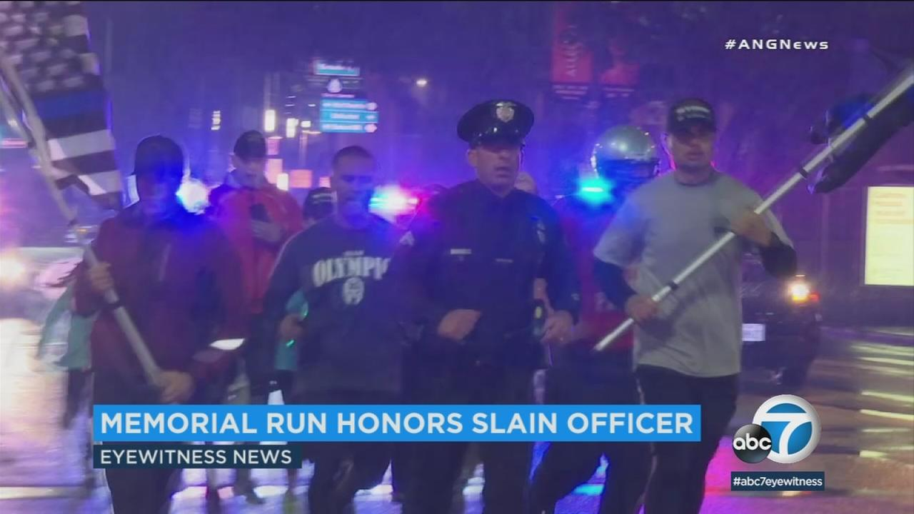 LAPD Officer Joe Cirrito finishes a 90-mile run on Sunday, March 11, 2018, to honor an officer killed 55 years ago.