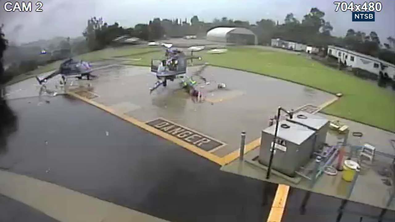 A surveillance camera captured shocking footage of two helicopters colliding on the Pasadena Police Departments heliport.