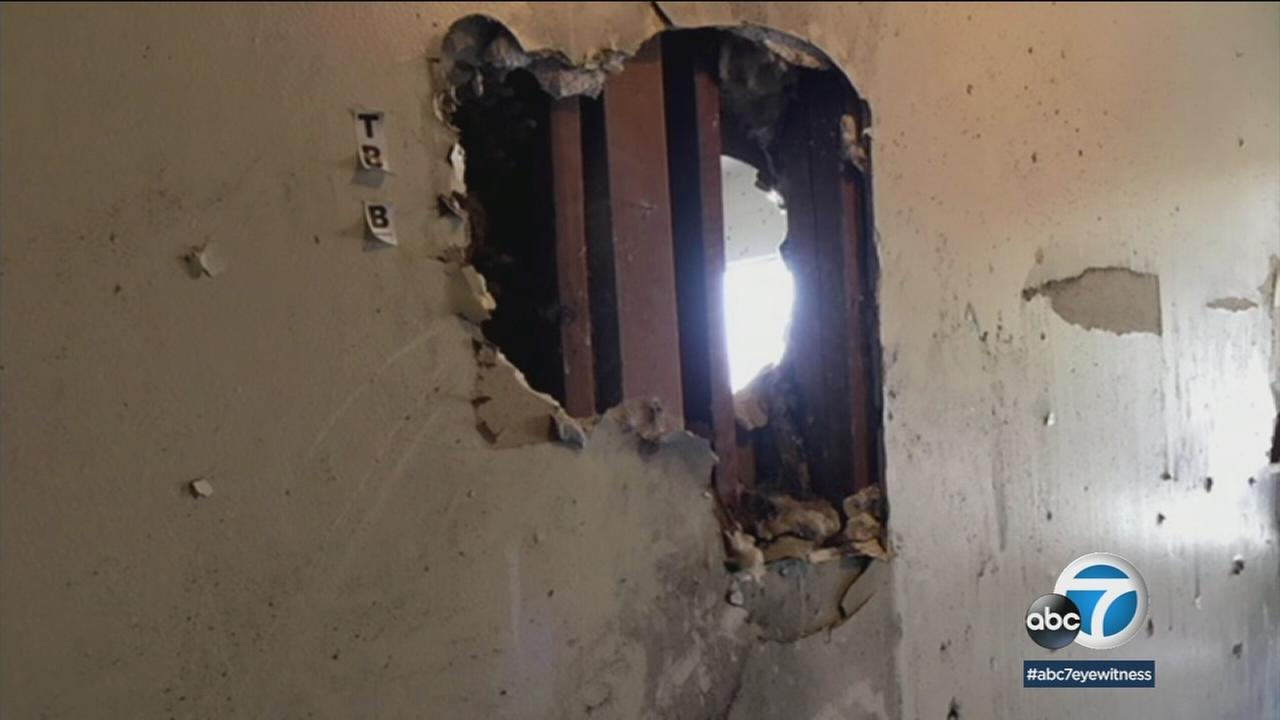 Pomona police say suspect Isaias Valencia shot holes in the walls of his apartment in an effort to escape during a lengthy standoff.