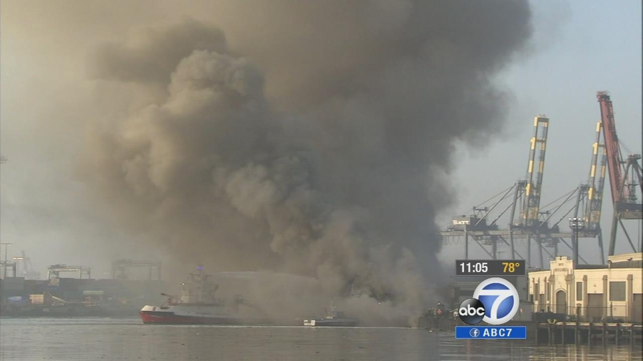 Smoke is seen at the Port of Los Angeles on Tuesday, Sept. 23, 2014.