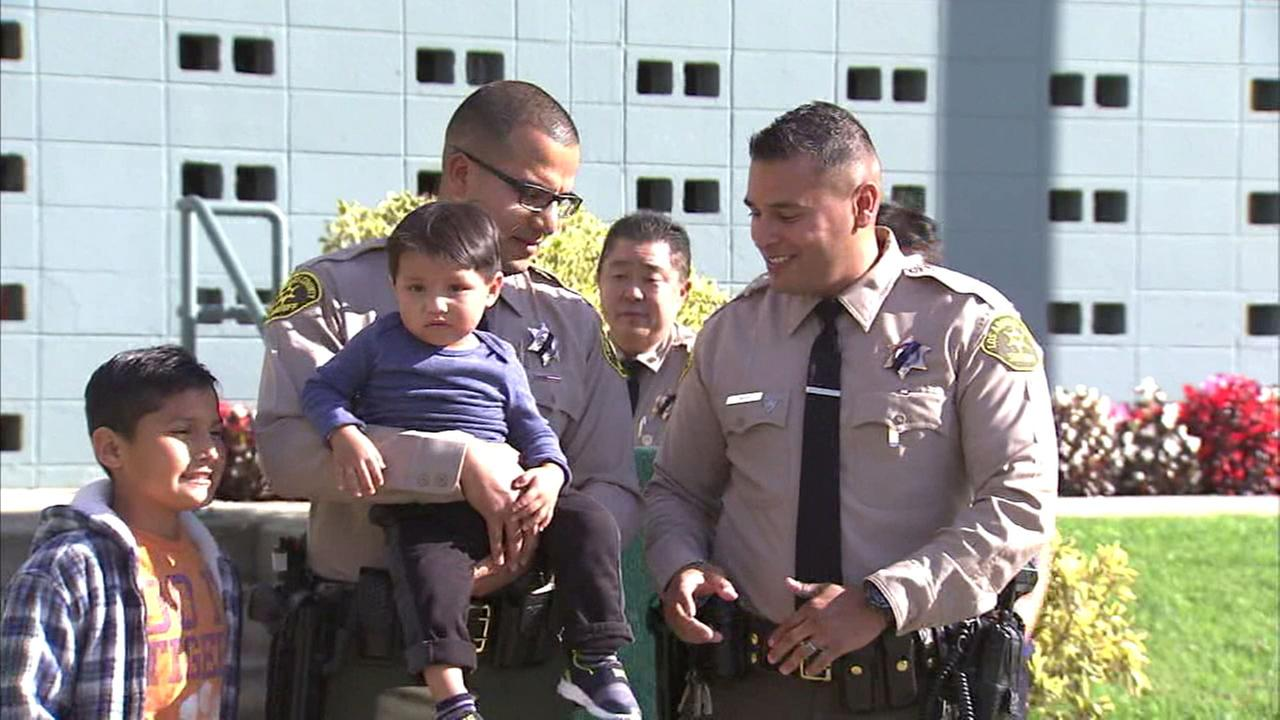 Two Los Angeles County sheriffs deputies reunited with the toddler they helped save using CPR in La Puente.