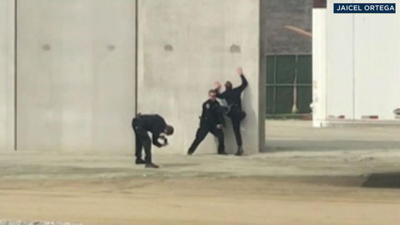 A video captured by Jaciel Ortega appears to show San Diego police officers posing at a border wall prototype in Otay Mesa.