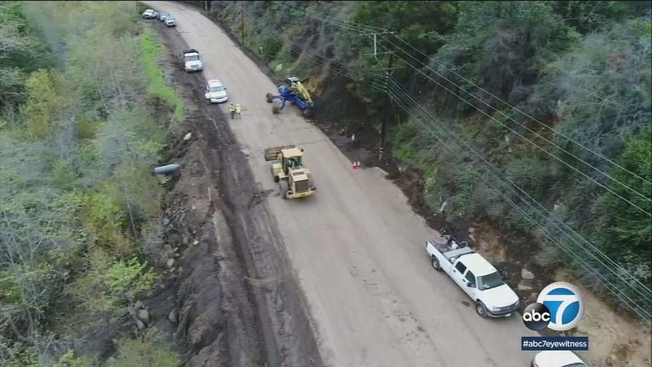 Fridays rains slowed cleanup efforts, but crews were able to reopen Topanga Canyon Saturday.