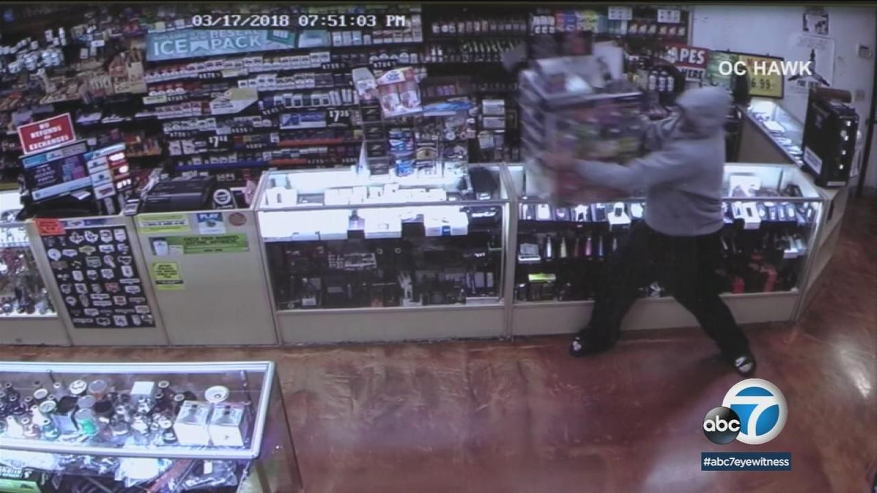 A Huntington Beach bandit was caught on camera snatching a case full of lottery tickets in Huntington Beach Saturday, March 17, 2018.