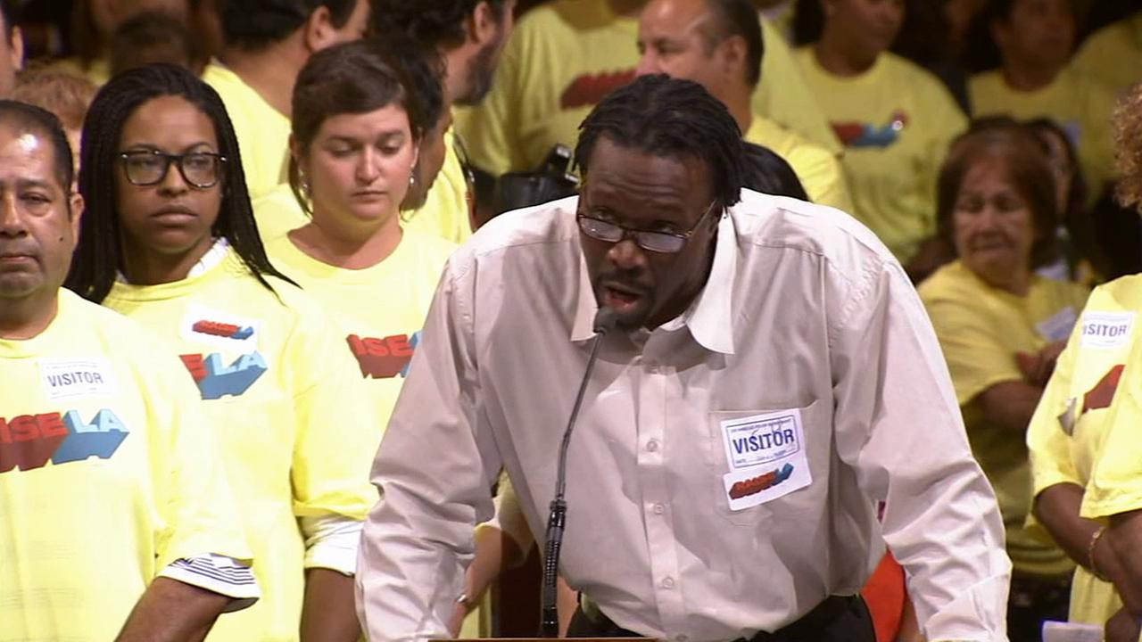 A man speaks out before a vote to increase minimum wage for hotel workers in L.A. on Wednesday, Sept. 24, 2014.