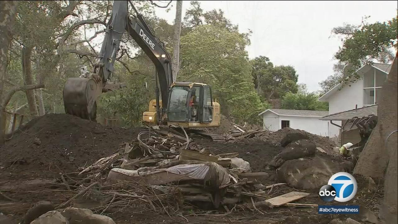 Crews work to clear existing debris in Montecito as heavy rain is expected.