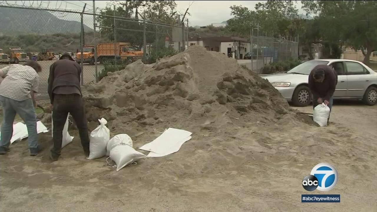 People gathered sandbags in preparation for the storm Tuesday in parts of Los Angeles County that were charred by wildfires.