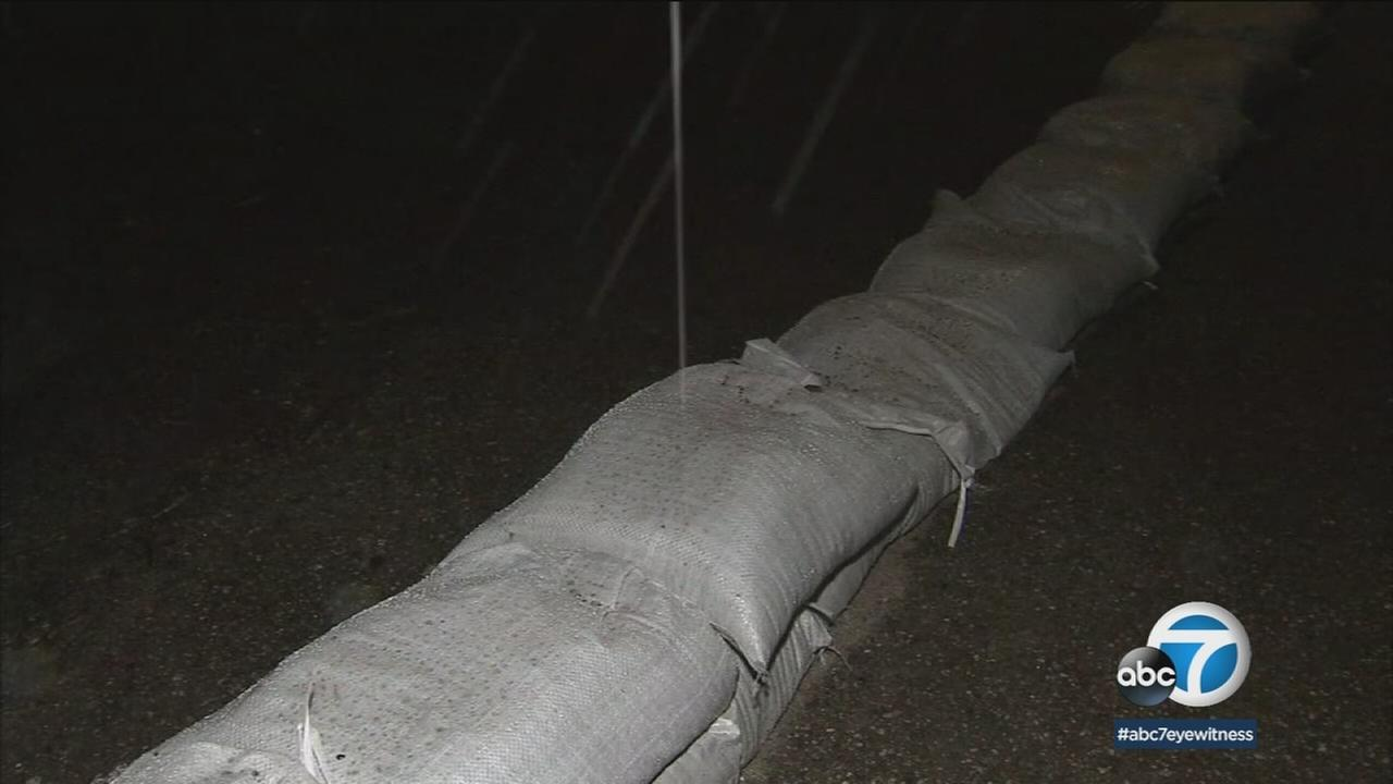 Sandbags are shown in the La Tuna Canyon area as a powerful storm heads into the area.