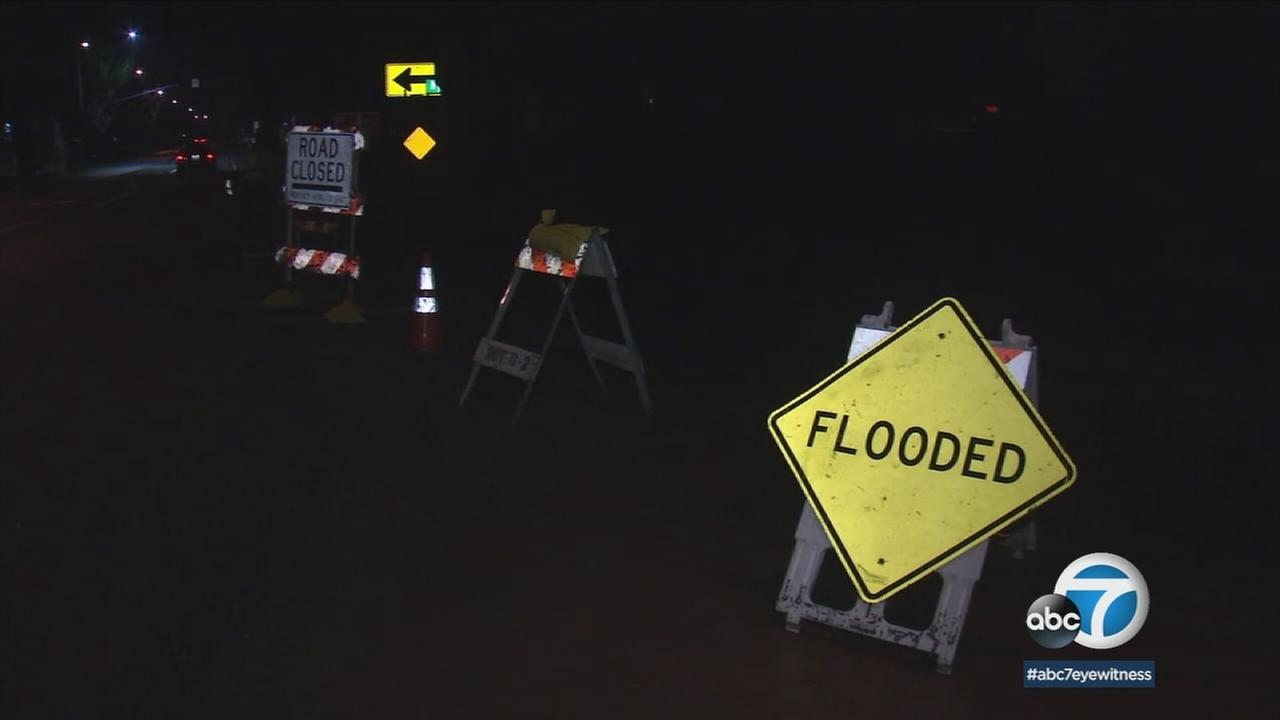 A sign warned residents and drivers of a flooded street after heavy rains inundated parts of Ventura on Wednesday, March 21, 2018.
