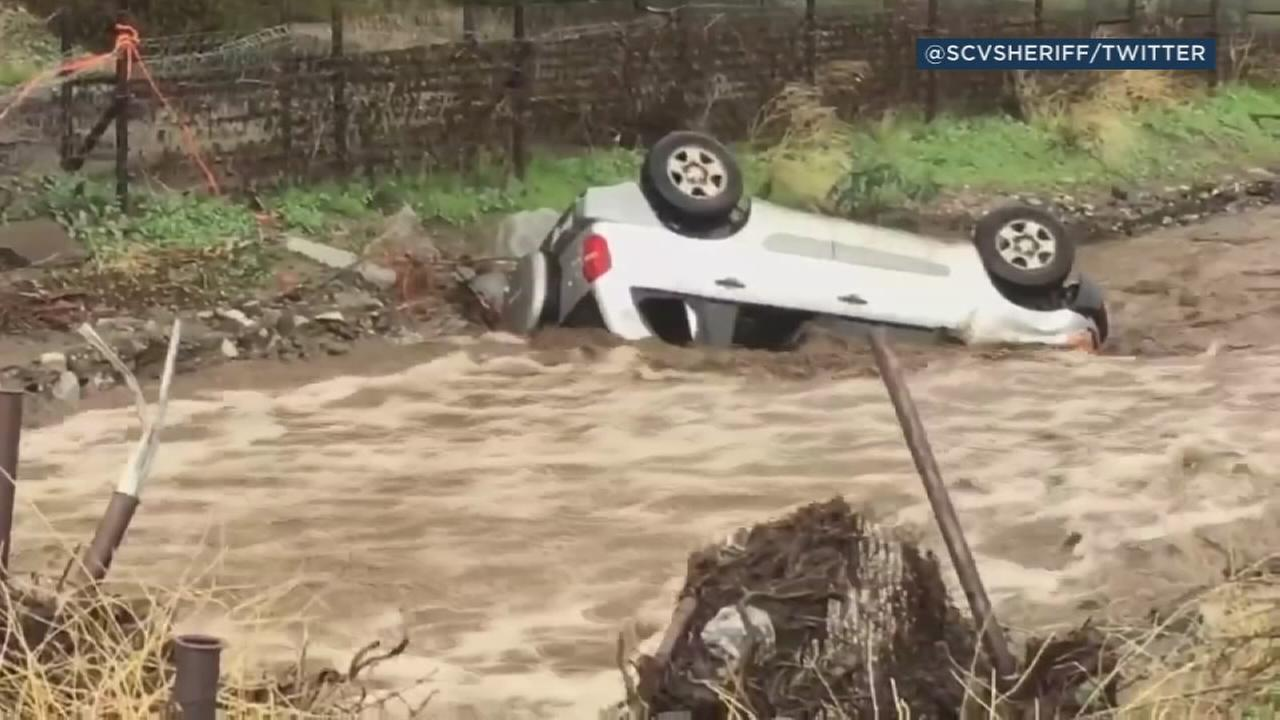 A still image from video posted by the Los Angeles County Sheriffs Department shows a car that has been swept away by floodwaters in Santa Clarita on Thursday, March 22, 2018.
