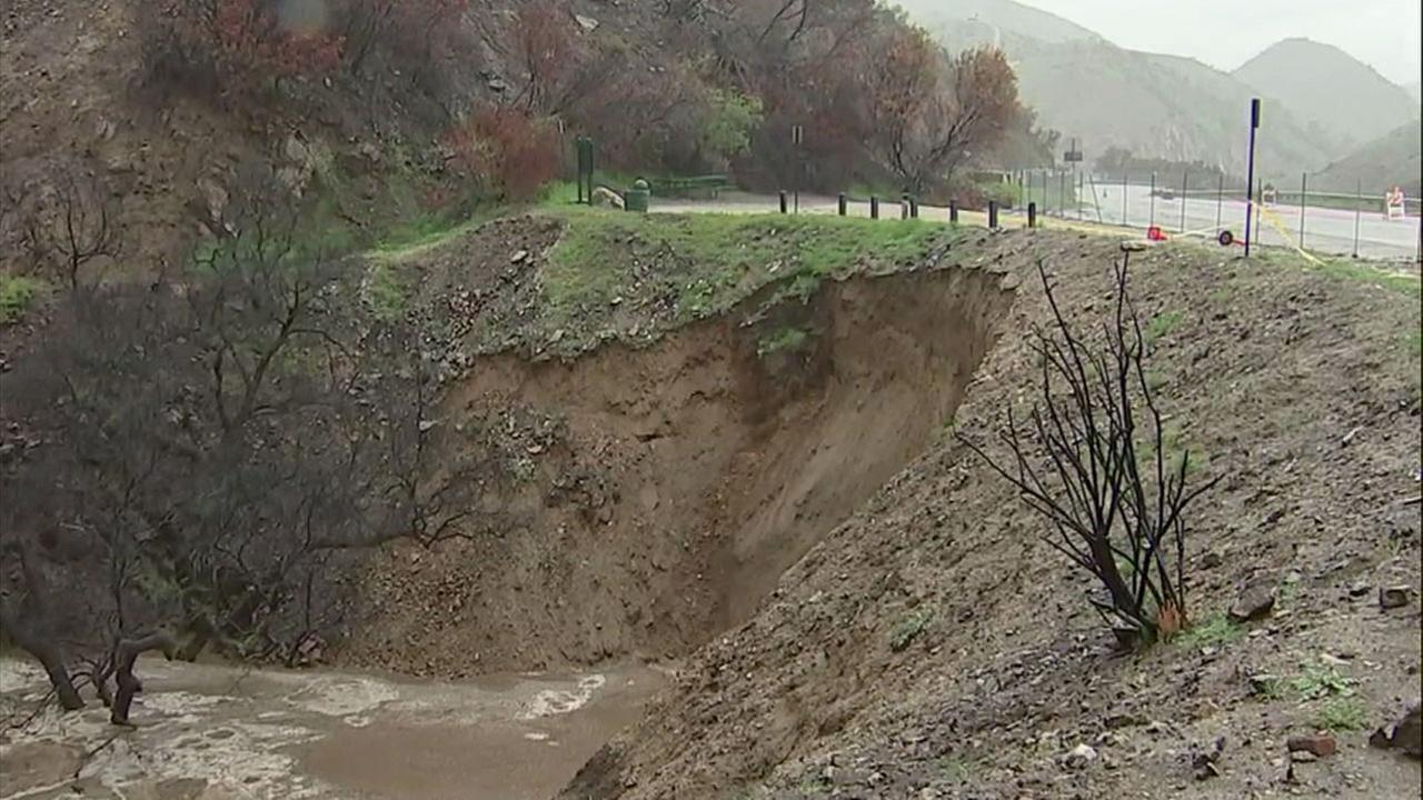 A hillside is shown collapsing in La Tuna Canyon after being inundated with heavy rains on Thursday, March 22, 2018.
