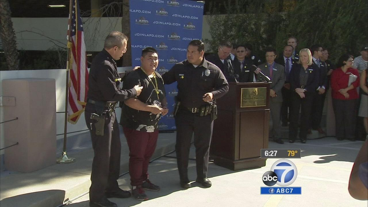 Sunshine Kids get to be an honorary Los Angeles police officer on Thursday, Sept. 25, 2014.