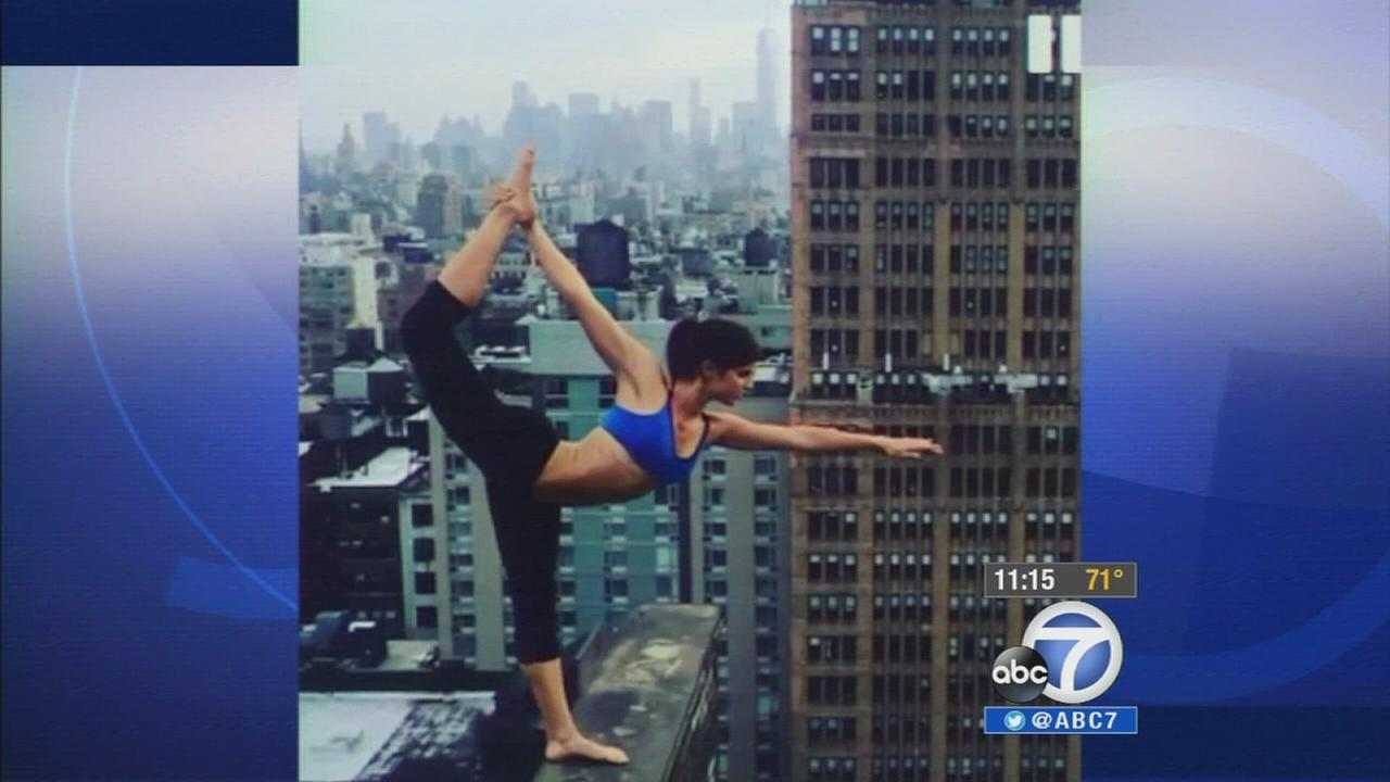Santa Monica actress Rachele Brooke Smith stretches into a yoga pose on a ledge 25 stories above ground in New York City.