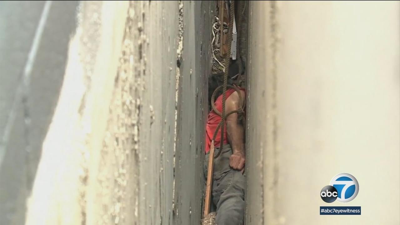A man seen trapped between two buildings in Honolulu, Hawaii.
