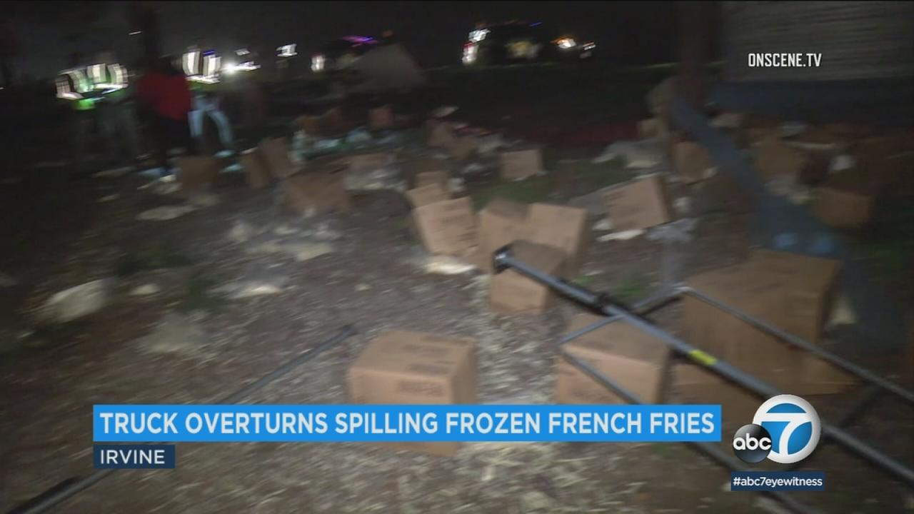 A truck carrying boxes of frozen McDonalds French fries overturned on the 5 Freeway in Irvine, spilling the load along the road.