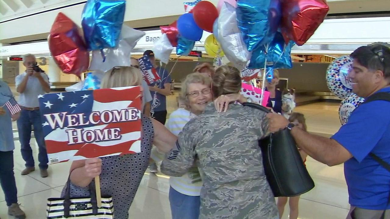 Air Force Master Sgt. Deanna Swick hugs her family after returning home at Ontario Airport on Friday, Sept. 26, 2014.
