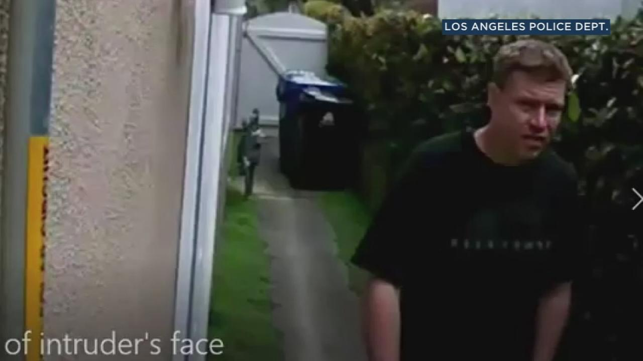 A man, who is suspected of trying to burglarize a home in Los Angeles while a family attending a funeral, is shown in surveillance video on March 11, 2018.