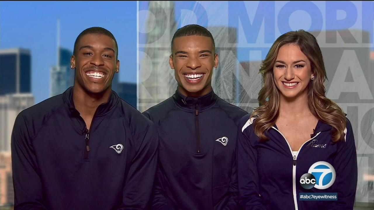 Quinton Peron and Napolean Jinnies are shown in a photo during an interview with Good Morning America about their first-ever spots on a cheer team in the NFL.