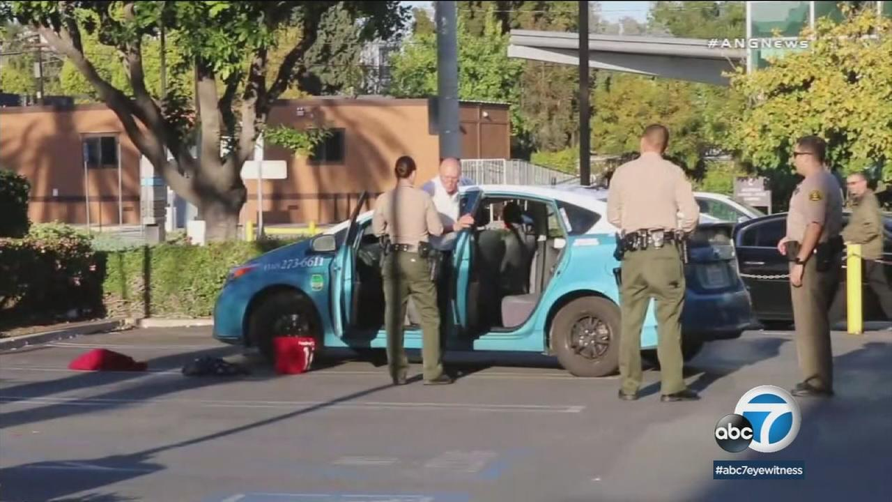 Sheriffs deputies arrested a man suspected in robberies of two banks in West Hollywood as he tried to flee in a taxi, officials said.
