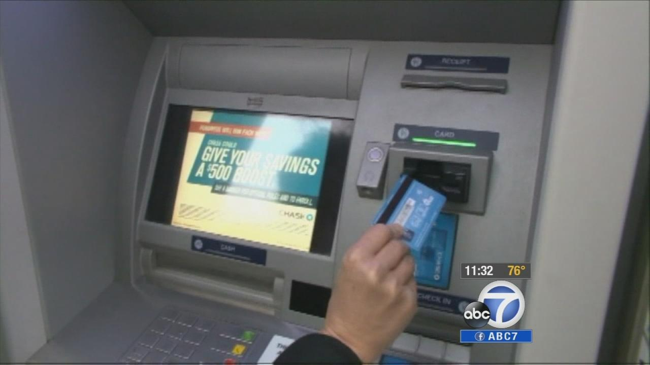 A woman uses an ATM in the Los Angeles area on Monday, Sept. 29, 2014.