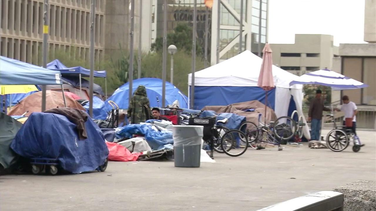 A homeless encampment is shown in a photo.