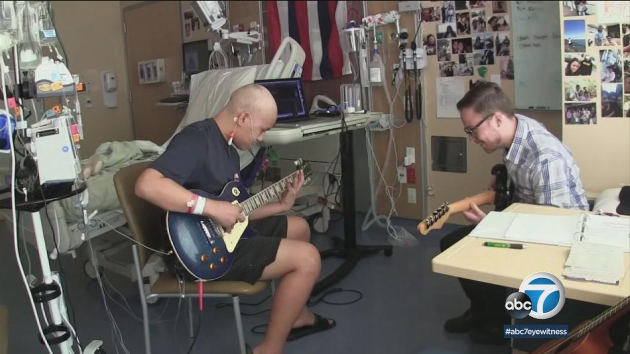 Two of four friends jam together as they recover from bone marrow transplants at UCSF Childrens Hospital.