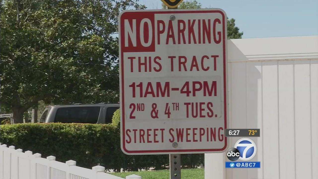 Residents in a Costa Mesa neighborhood are complaining that a lack of street sweeping signs is costing them more money in the form of parking tickets.