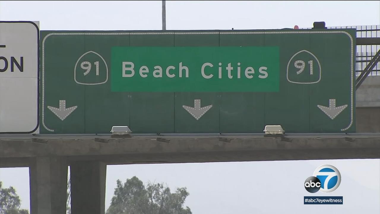 A sign on the 91 Freeway reads, beach cities.