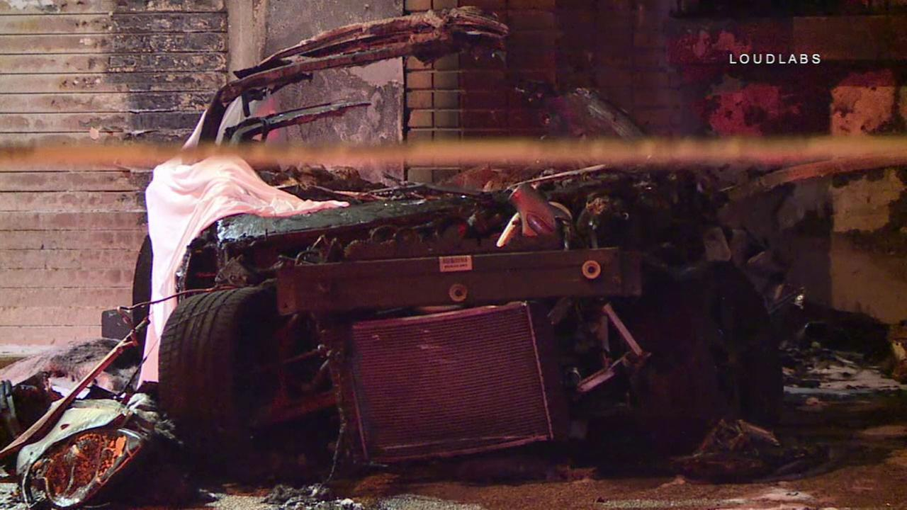 What is left of a Corvette that crashed into a building and burst into flames, leaving two people dead on Wednesday, April 4, 2018.