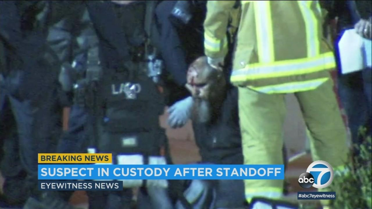 A Los Angeles Police Department K-9 dog was wounded Friday evening as officers took a suspect into custody at the end of an hourslong standoff at a North Hollywood motel.