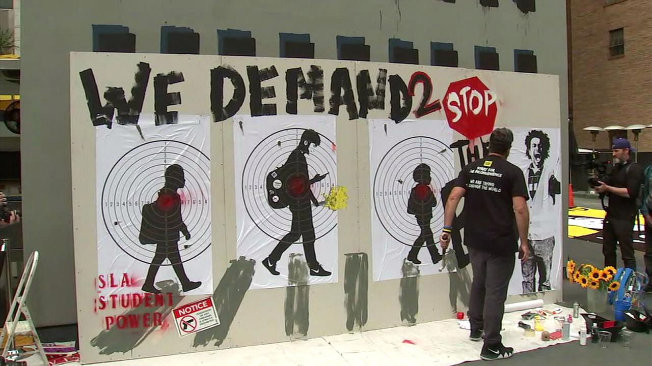 Manuel Oliver, the father of a slain Parkland school student, is shown creating a mural to start the conversation on gun violence in downtown L.A.