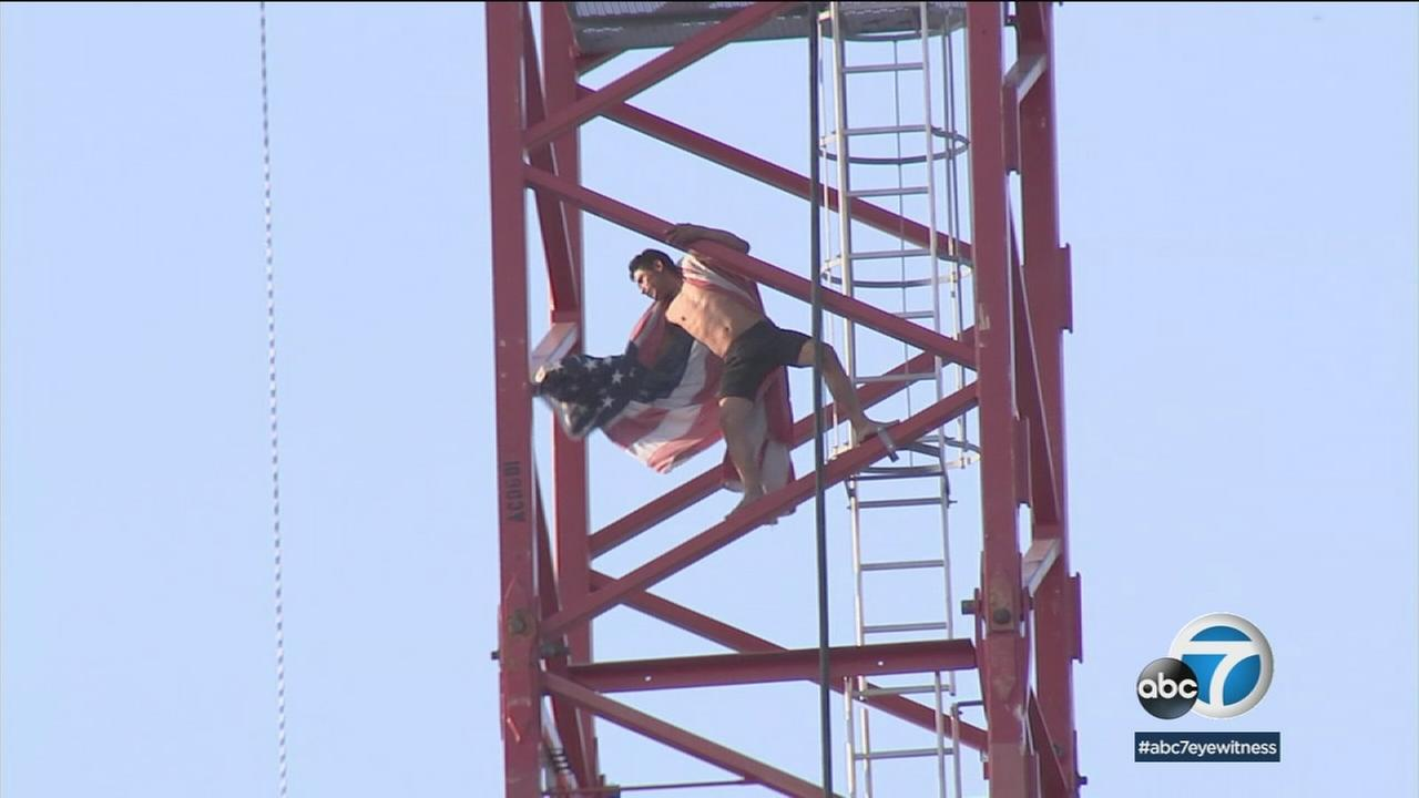 A man climbed a tall construction crane some 200 feet above Hollywood Boulevard and stayed up there for hours before safely coming down.